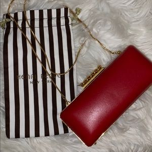 Henri Bendel red and gold clutch.